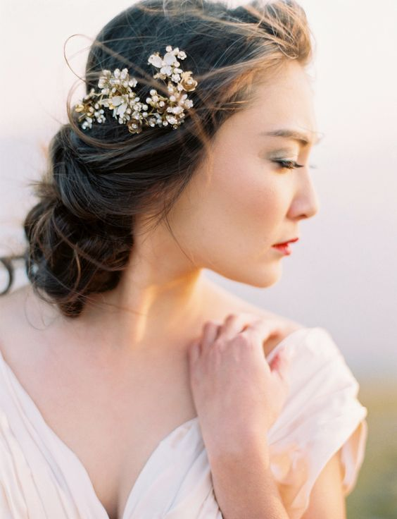a beautiful gold and pearl wedding hairpiece to highlight the low updo is a gorgeous option