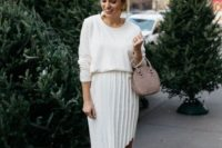 18 a stylish and casual look with a white top, a pleated asymmetrical midi, dusty pink shoes and a matching bag