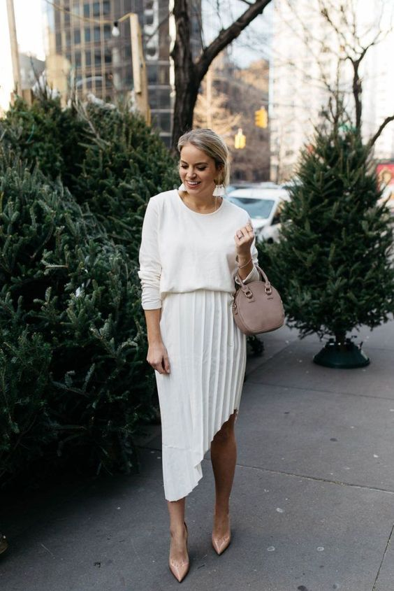 a stylish and casual look with a white top, a pleated asymmetrical midi, dusty pink shoes and a matching bag