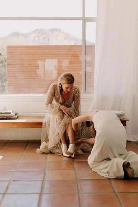 silver booties paired with an embellished wedding dress are a gorgeous combo to rock