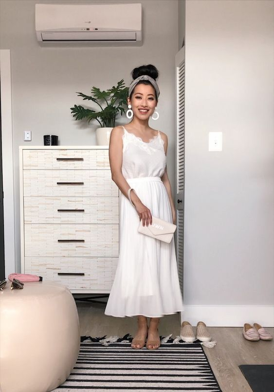 a white lace spaghetti strap top, a midi white skirt, nude flats and a white clutch for a casual bride-to-be