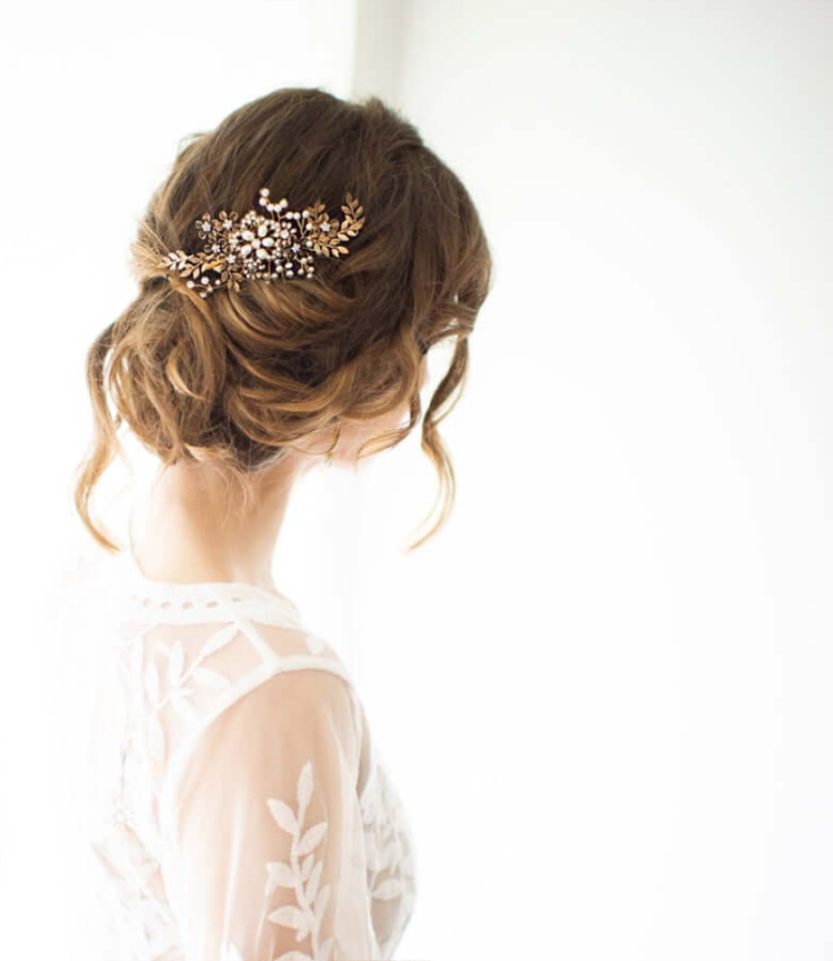 a beautiful vintage-inspired fold wedding hairpiece with rhinestones and pearls is a fantastic accessory to try