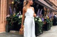 21 a white midi dress with buttons on one side,  halter neckline, white shoes and a wooden bag for a summer bride-to-be