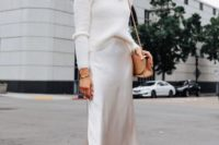 24 a winter bridal shower look with a turtleneck, a silk slip midi, nude shoes and a camel bag