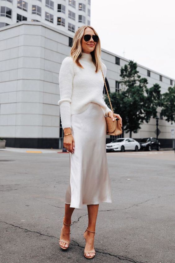 a winter bridal shower look with a turtleneck, a silk slip midi, nude shoes and a camel bag