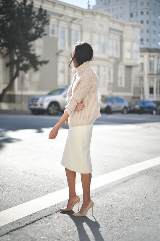 a winter bridal shower outfit with a chunky knit sweater, a midi skirt, nude shoes is simple and cool
