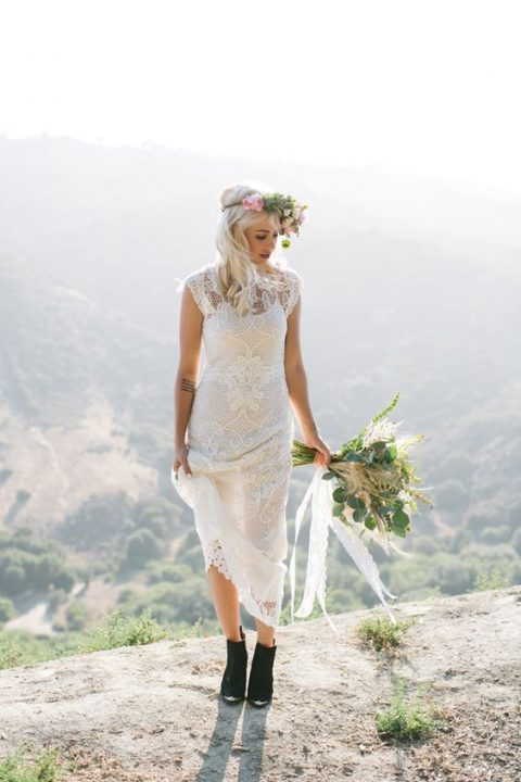 black suede booties with heels paired with a sheath wedding dress for a bold boho look