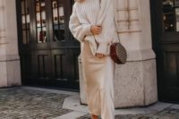 26 a winter outfit with an oversized sweater, a silk slip midi skirt, white booties and a brown crossbody bag
