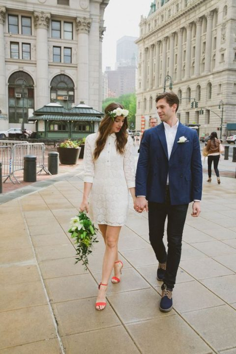 a boho lace mini wedding shirtdress with short sleeves, red shoes and a floral crown for a flower child bride