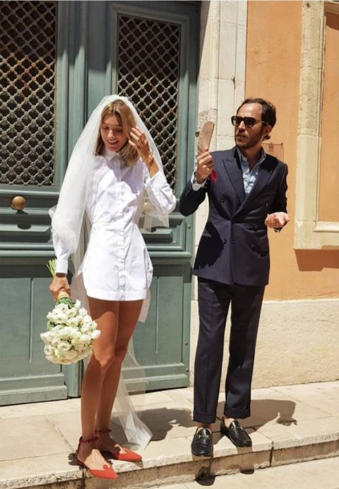 a mini wedding shirtdress, red flats, a veil for a bold and non-traditional look at your wedding
