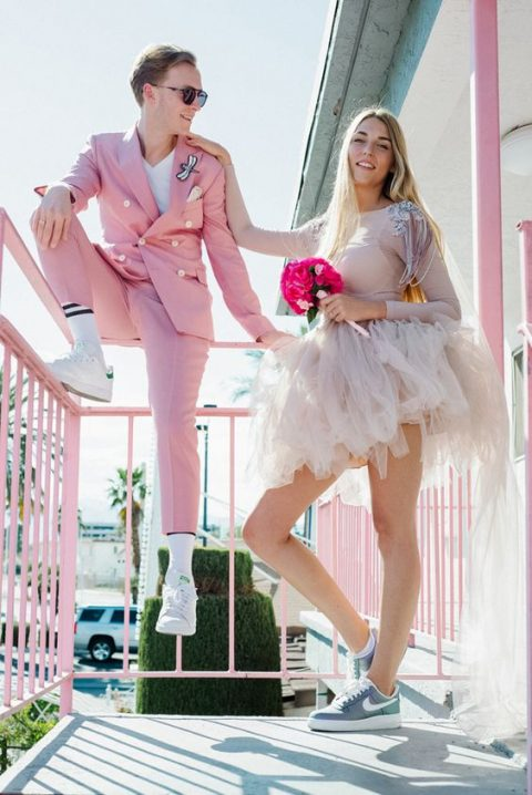 a pink mini dress with a plain long sleeve top and a tutu skirt plus blue Nike sneakers for a Las Vegas bride