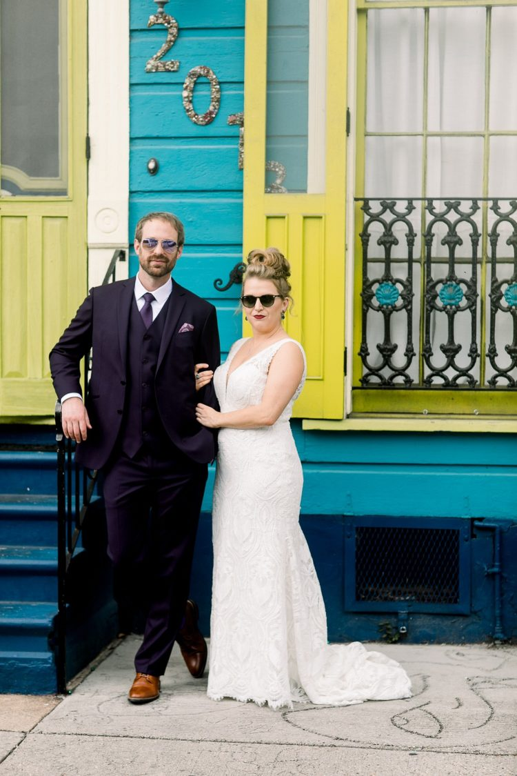 This funky wedding took place in New Orleans and was done with glitter, feathers and bright colors