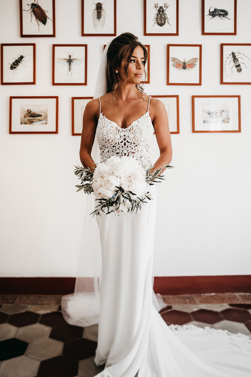 The bride looked stunning in her fitting wedding dress with a lace bodice and a sleek skirt with a train