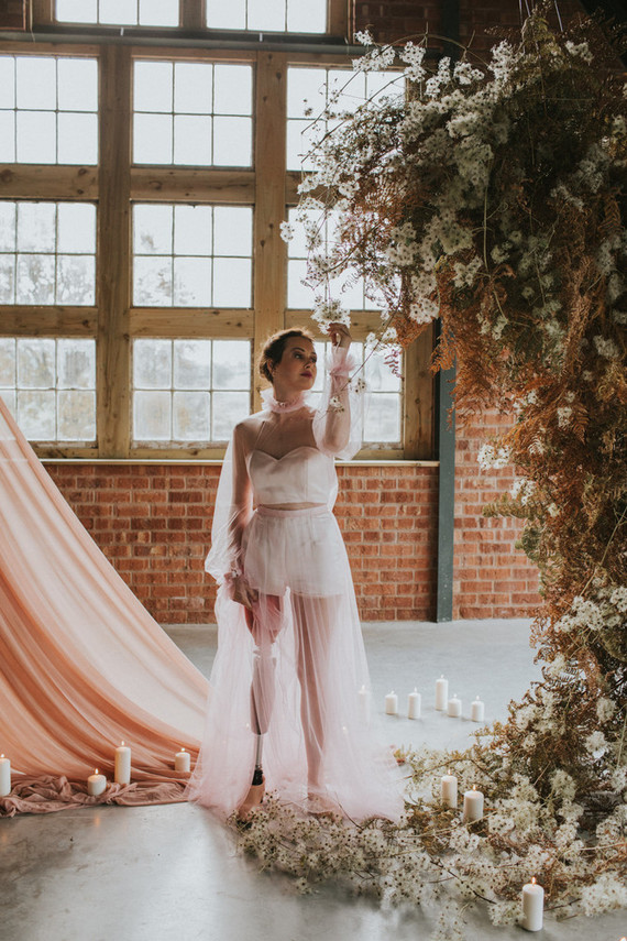 The wedding dress was created for the bride, her sheer pink top and skirt showed off her leg
