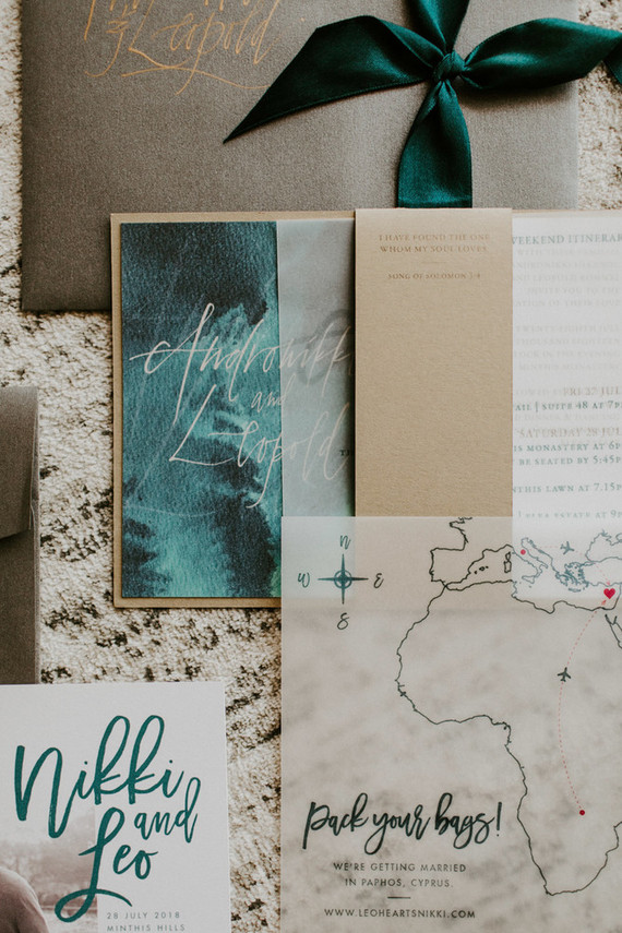 The wedding stationery was done in green and neutrals, with cool maps of the islands