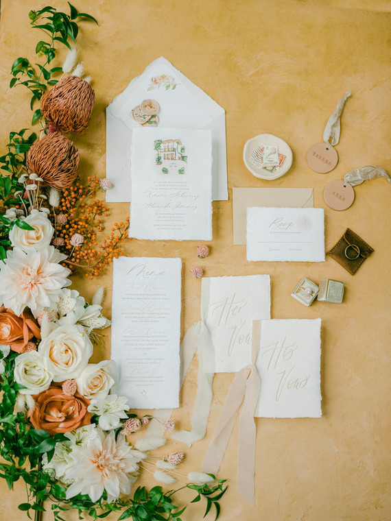 The wedding stationery was done neutral, with some drawings of the local spaces