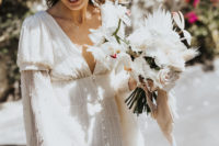03 The bride was rocking a gorgeous A-line fully pearled wedding dress with bell sleeves and a V-neckline