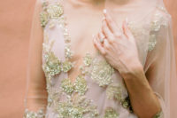 03 The bride was wearing a fantastic blue wedding dress with gold embroidery and beading, with a plunging neckline and short sleeves