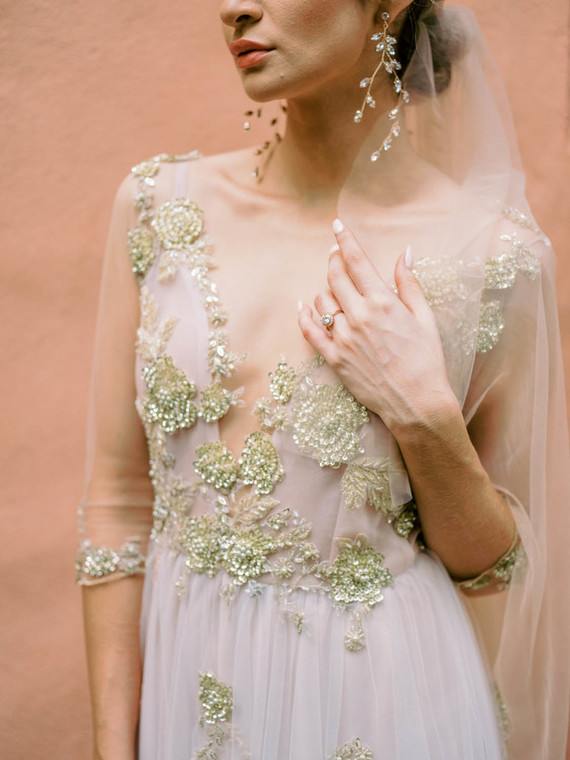 The bride was wearing a fantastic blue wedding dress with gold embroidery and beading, with a plunging neckline and short sleeves