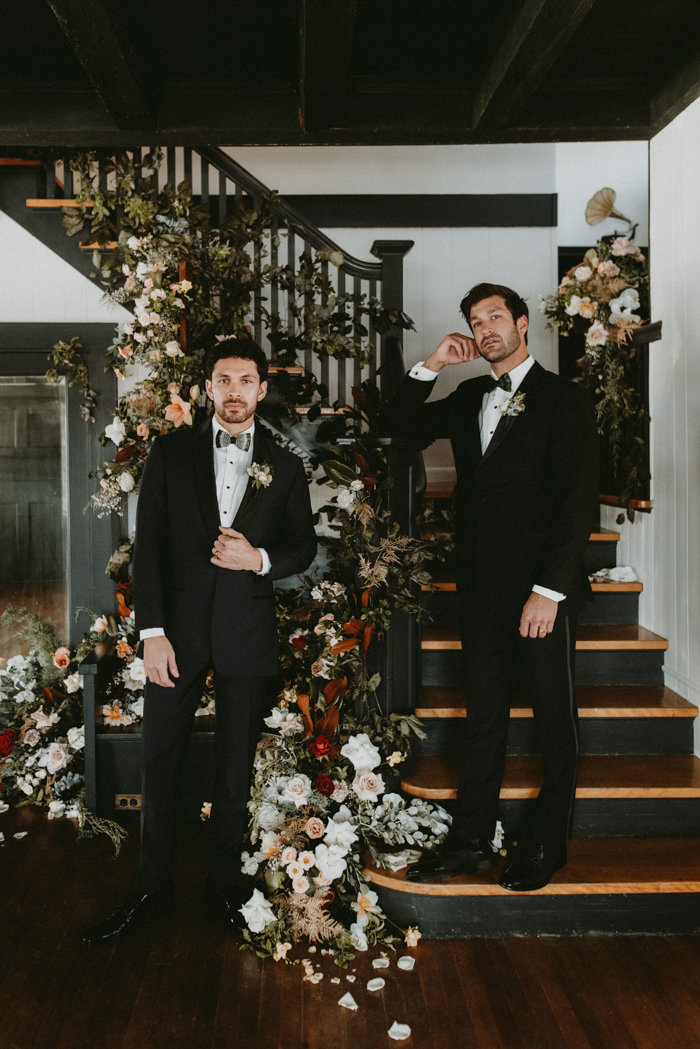 The grooms were wearing super elegant black tuxes with catchy printed bow ties