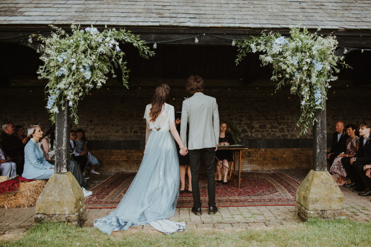 The wedding ceremony was simple and sweet, with blue blooms and greenery