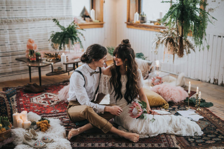 a home anniversary setting decorated in boho style and the couple wearing their wedding clothes again