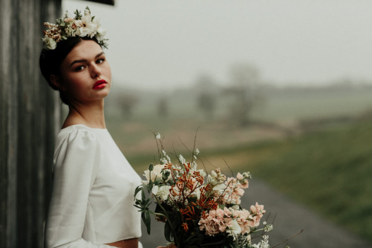 The bride was carrying a tender blush and white wedding bouquet and rocking a matching crown