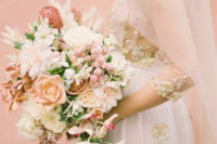 04 The wedding bouquet was done in peachy, pink and blush tones plus greenery