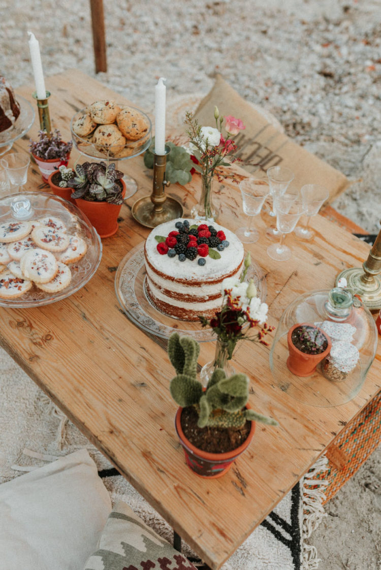 There was a pre-wedding picnic for gals on the beach, the table was styled with bright blooms and cacti plus delicious sweets and a naked wedding cake