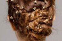 04 a fully braided low updo with tiny gold rhinestone star pins for a celestial look