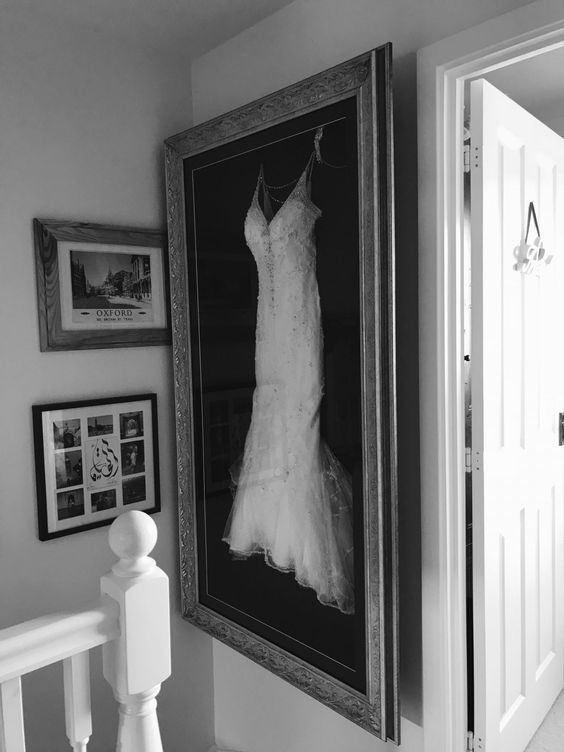 such a wedding dress display is a cool idea to show off the beauty while you aren't wearing it