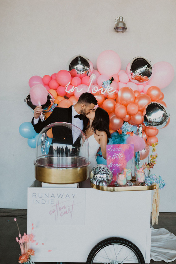 All the details and decor were fun and bright, with colorful ballooms and a cart