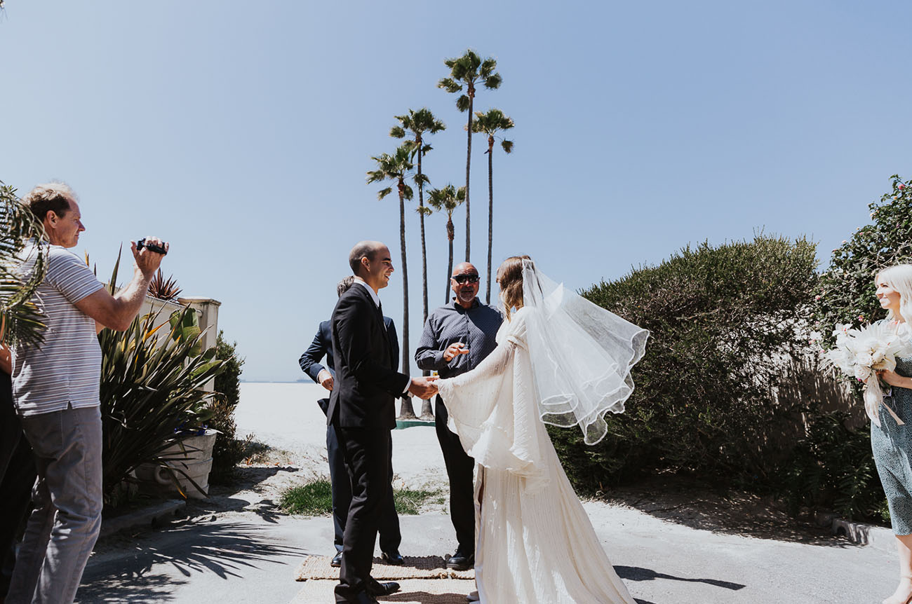 The elopement took place on the beach where the couple grew up with their families