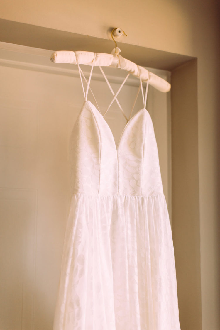 hang your wedding dress correctly using ribbons that are inside your wedding dress