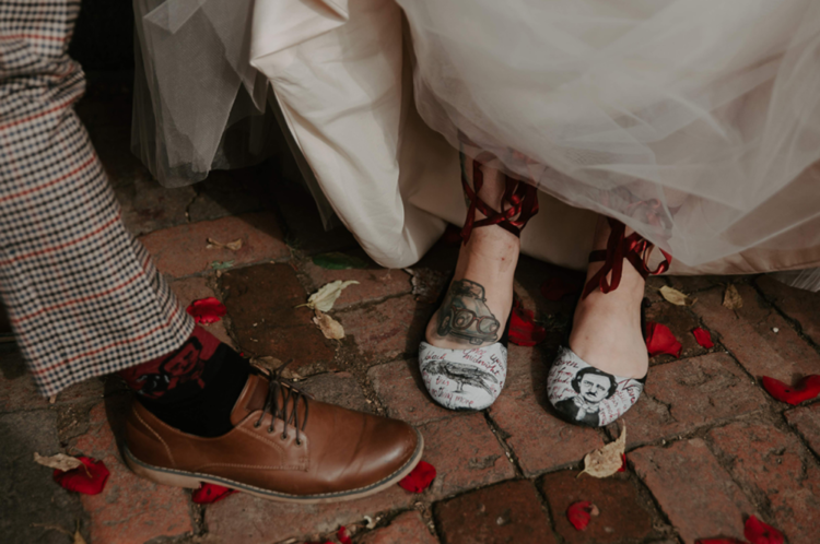 The bride was wearing Edgar Allan Poe shoes and the groom was wearing such socks