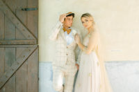 06 The groom was wearing a chic neutral plaid suit, a rust bow tie and moccasins plus a hat