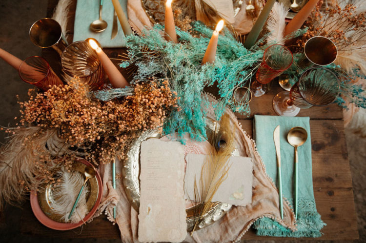 The reception table was styled with the same grasses and feathers, candles and colorful napkins
