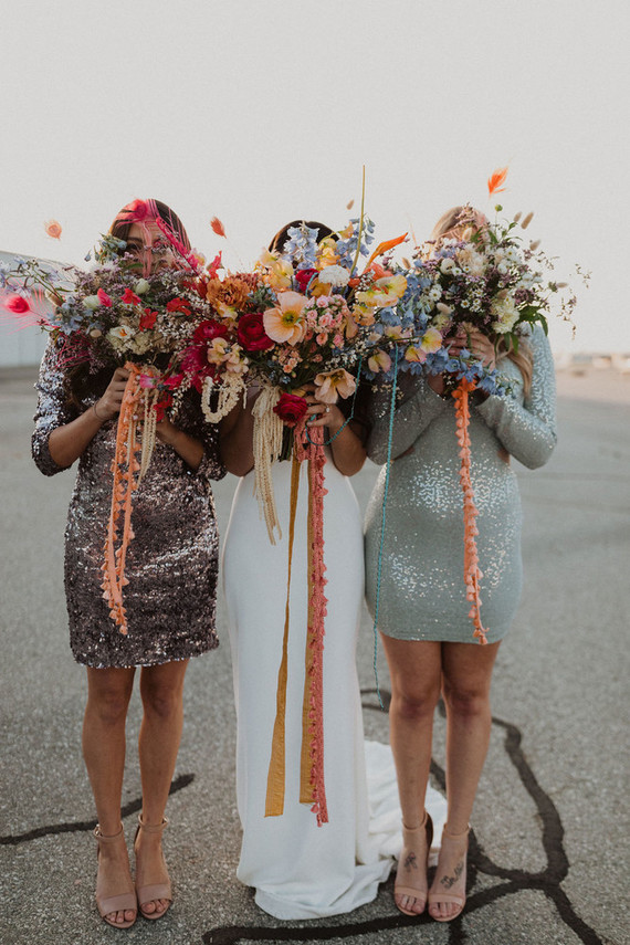 The bridesmaids were rocking sequin mini dresses with long sleeves and colorful bouquets