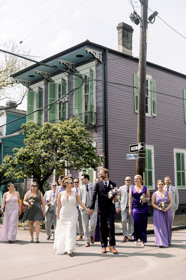 The groomsmen were rocking dove grey three-piece suits with purple ties