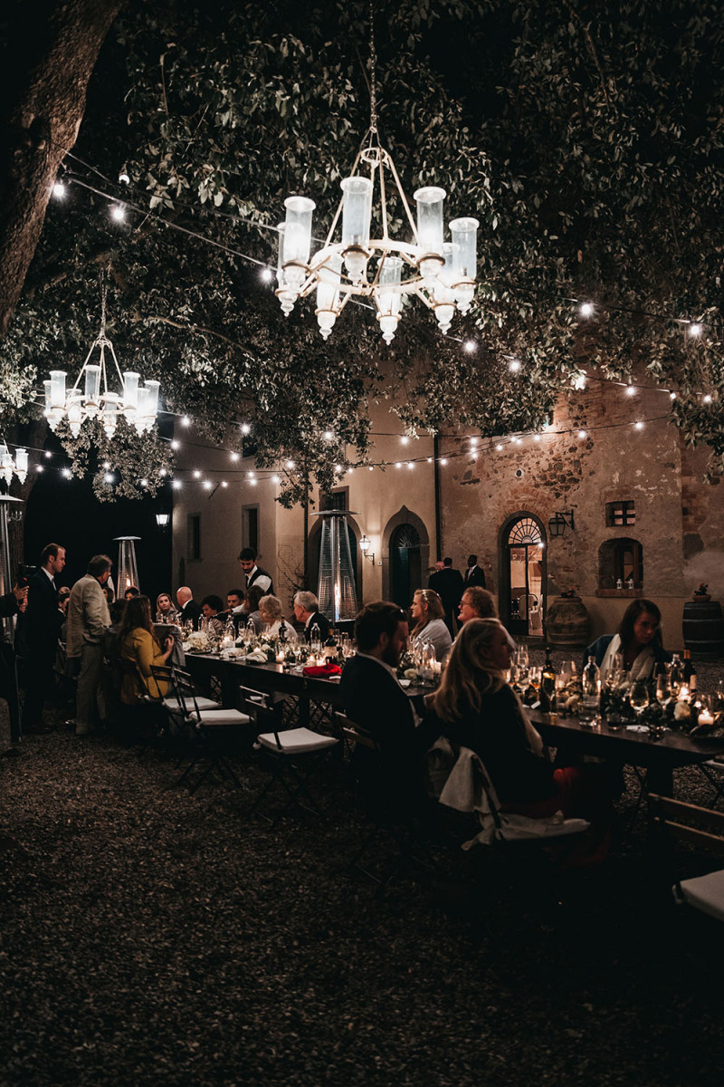 The reception took place outdoors, to enjoy fresh air and sunshine and lots of lights covered the space