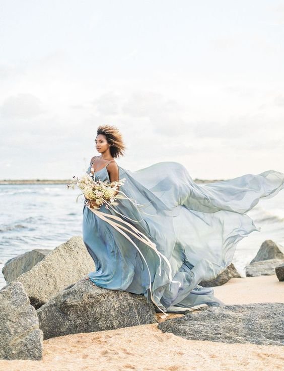 a super airy blue spaghetti strap wedding dress with a train will make a statement on any coast