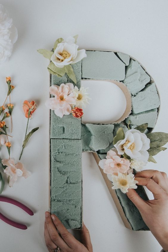 DIY a blooming monogram using cardboard, foam and some faux blooms in pastel colors