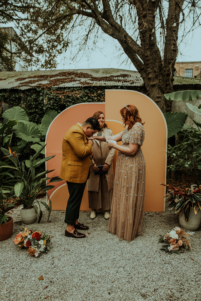 The wedding backdrop was bright and geometric, styled mid-century modern