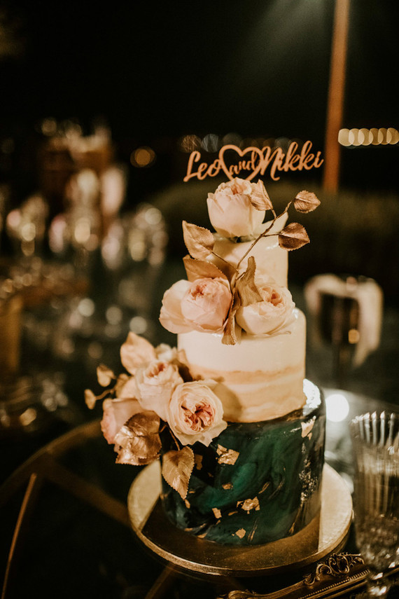 The wedding cake was a blush and watercolor emerald one with gold leaf and fresh blooms