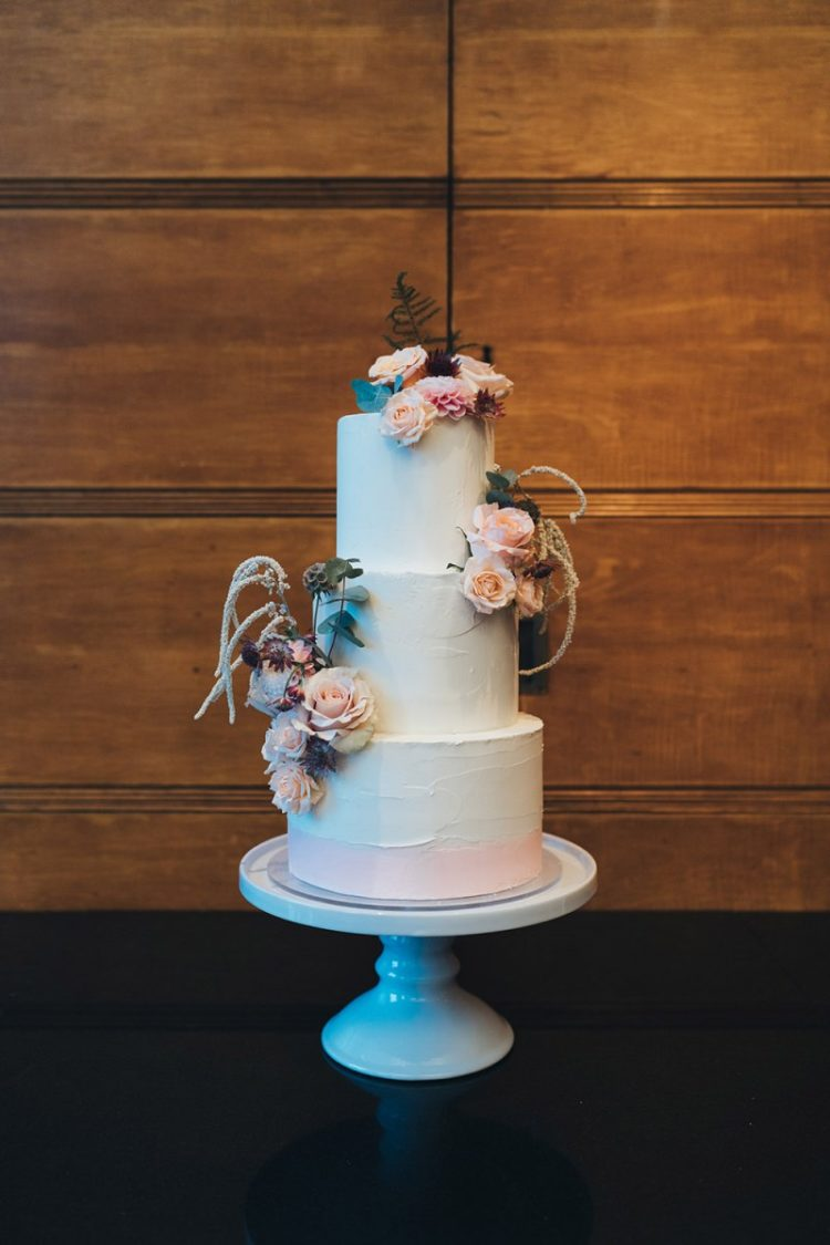 The wedding cake was a white textural one, with blush blooms and greenery