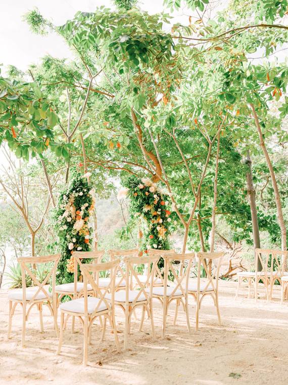 The wedding space was done with a lush greenery arch with peachy blooms