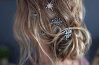 08 a messy and wavy low updo with various crystal star hair pins looks chic and very celestial