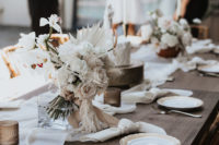 09 The decor was simple and white, with the wedding bouquet of white fronds and pale blooms