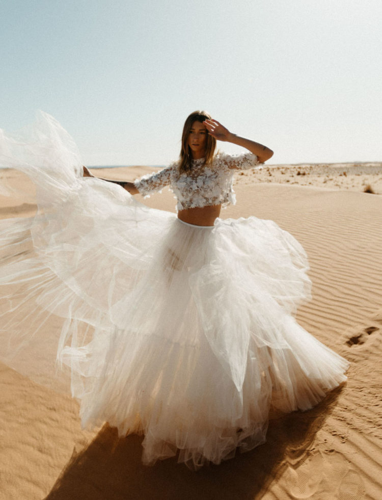 The second bridal look was done with an airy and embellished crop top plus a tiered tulle skirt