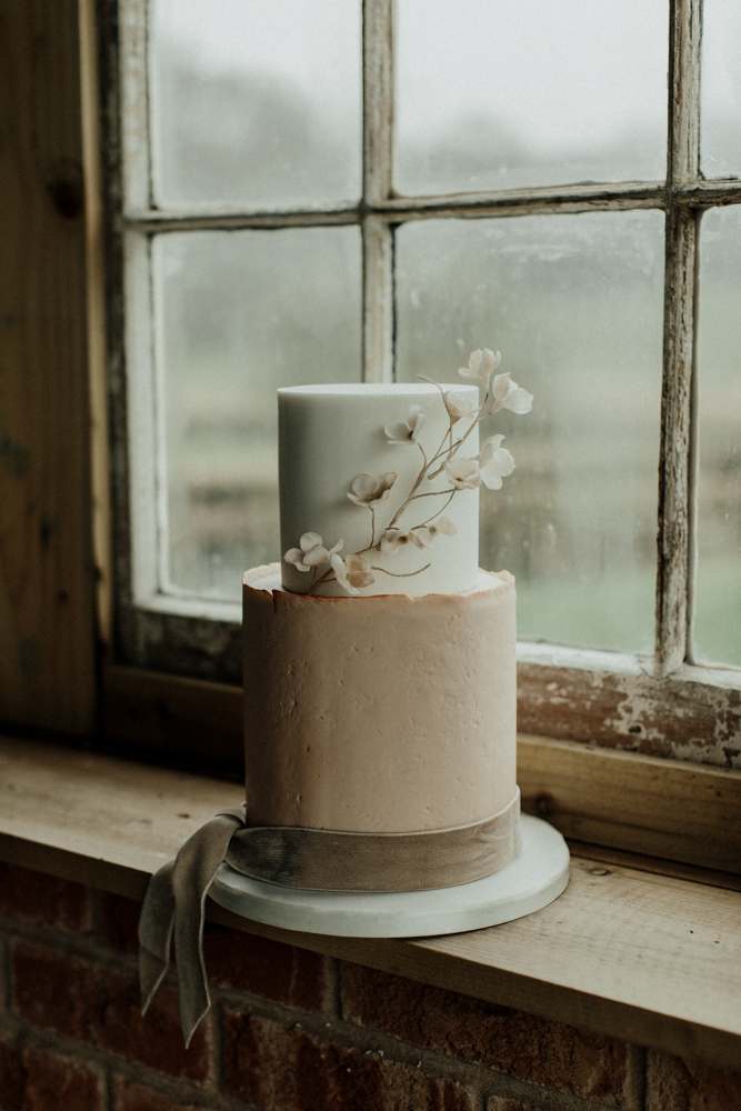 The wedding cake was a white and blush one, with fresh blooms and a velvet ribbon
